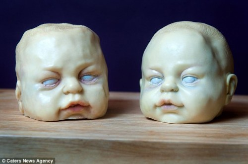 Baby heads made of white chocolate, from cake artist Annabel de Vetten.